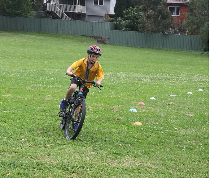 Student riding bicycle.