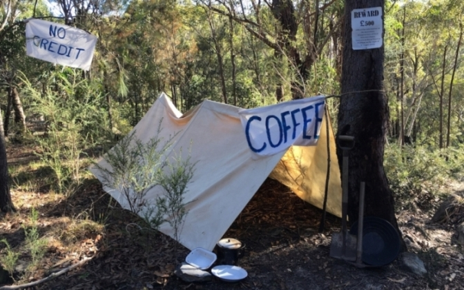 Tent and signs in bushland, recreating a camp site in the goldfields