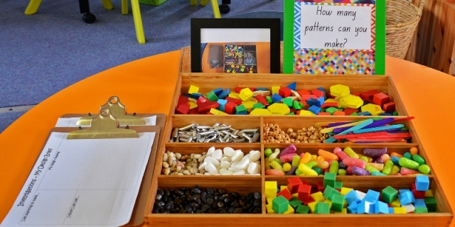 A learning station, inviting Kindergarten students to investigate patterns