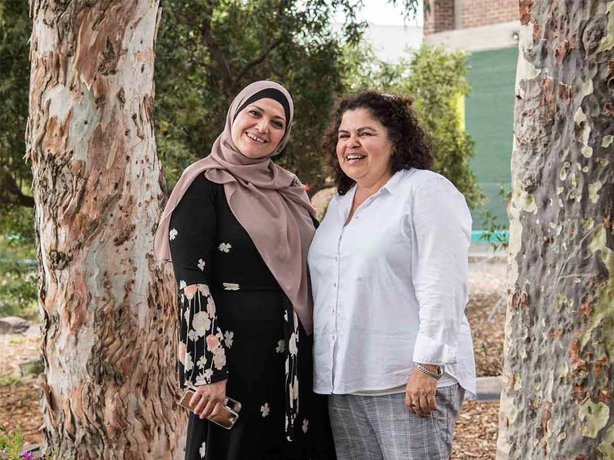 Valuing diversity: Muslim principal Hala Ramadan (left) and Aboriginal principal Fiona Kelly include their students and parents in cultural exchanges.