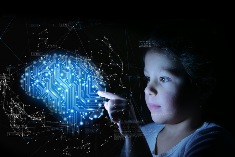 A child touching a blue circuit brain.