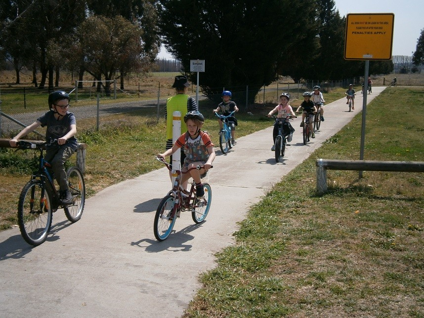 Children riding bicycles on a bike track.