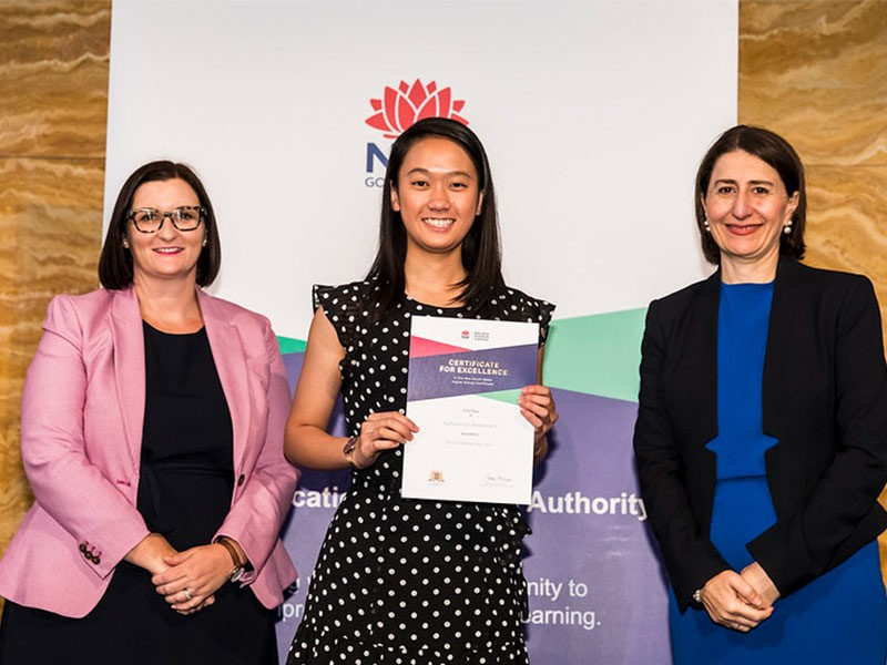 James Ruse Agricultural High School student Jocelin Shing-Yan Hon receives her award for First in Course for Extension 2 Mathematics from Education Minister Sarah Mitchell (left) and Premier Gladys Berejiklian (right).