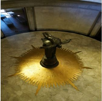 sculpture on gold plated star on floor