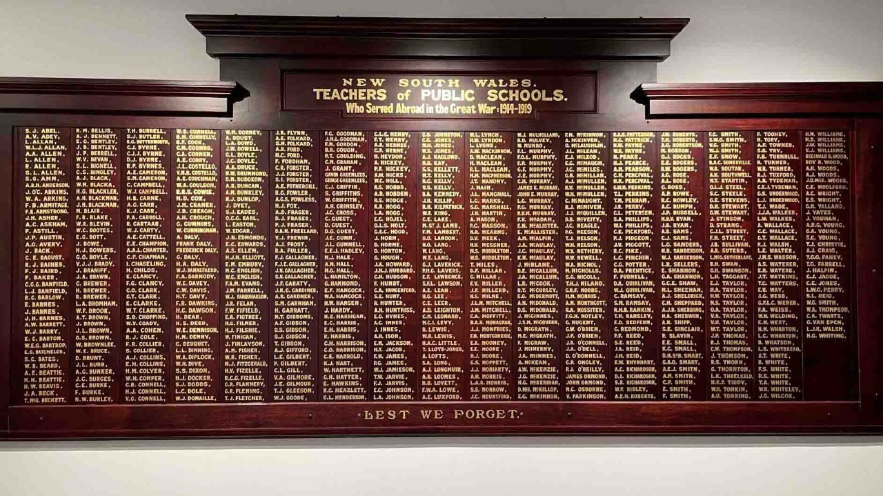 Brown honour board with gold lettering for names