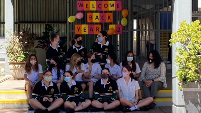 Group of school students wearing masks
