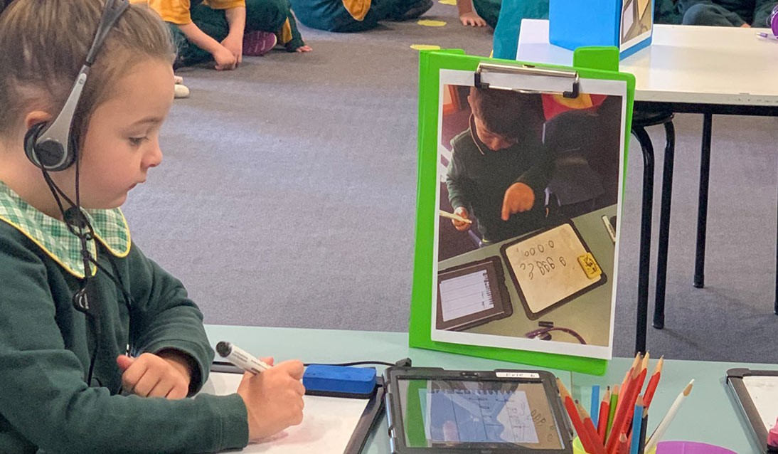 A student using a iPad in the classroom.