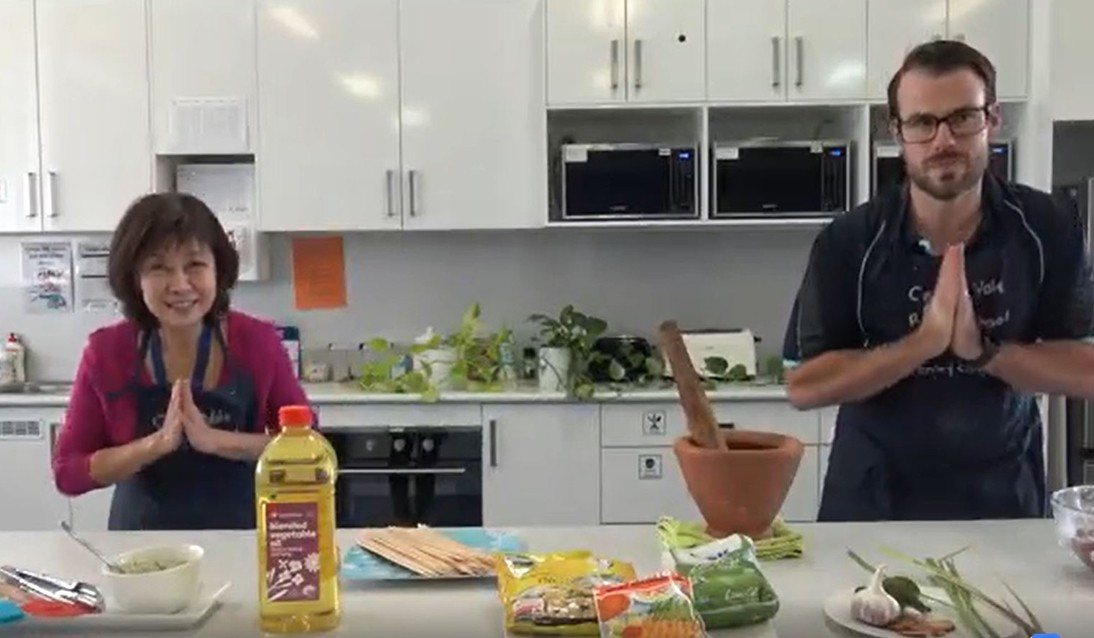 Mrs Ly and Mr Lanham bow for the camera over their table of ingredients in this still from the Facebook video.