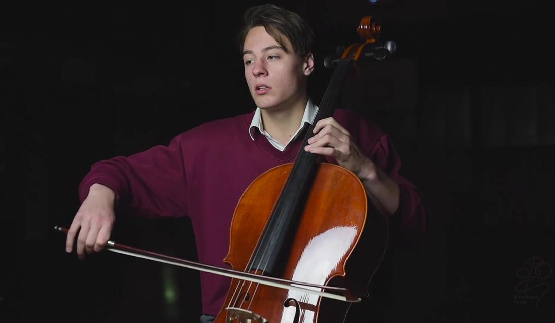 Jackson performing on the cello