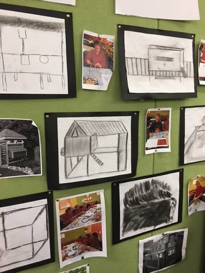 Noticeboard with student drawings of what their chicken coops could look like.