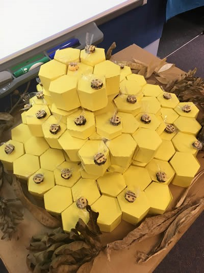 Yellow hexagons piled up to look like honeycomb.
