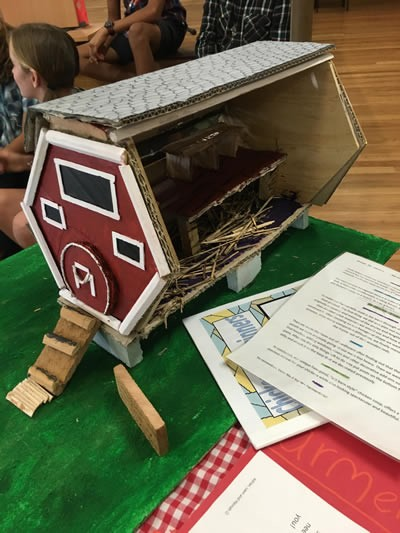 Student designed six sided chook house made from cardboard.
