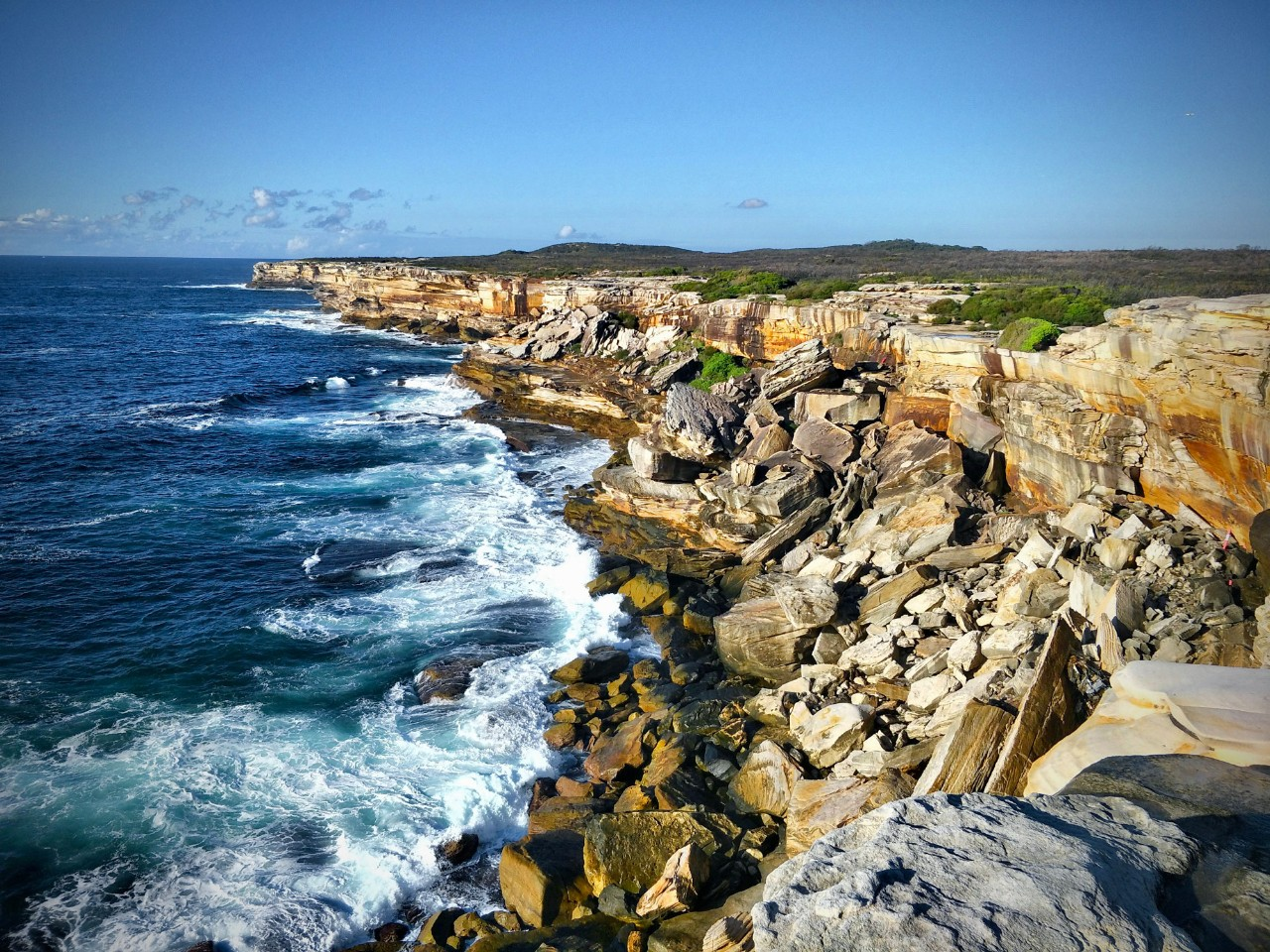 Cape Solander looking south with the ocean on the left of the cliffs