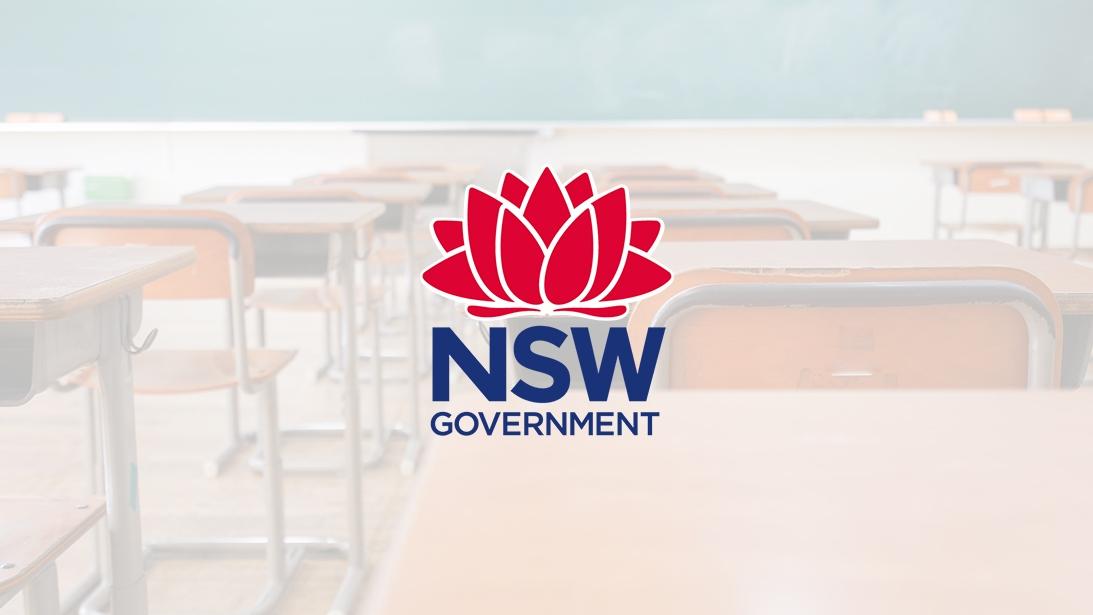 DoE logo overlaid on feint background image of a classroom
