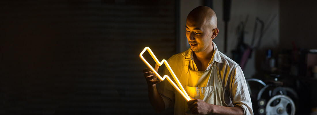 man holding a glowing lightning bolt